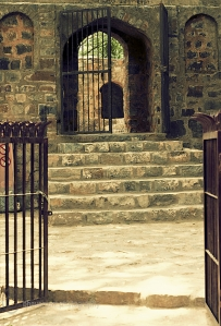 Wrought iron gates at the entrance of Agrasen ki Baoli