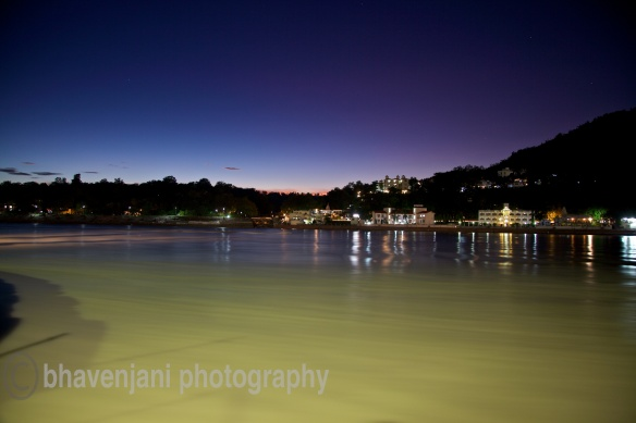 The sky turns blue and purple at the magic hour immediately after sunset as viewed from Swargashram in Rishikesh