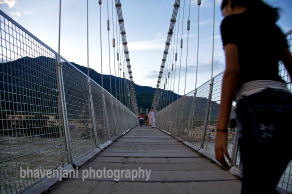 View of some people walking down Ram jhula on an early morning in Rishikesh