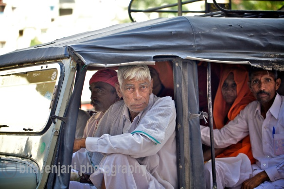 People sit cramped in a Jeep which is a common mode of transport in Rishikesh