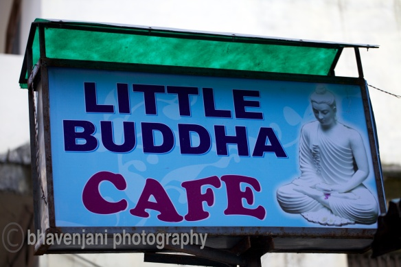 An cute sign-board 'Little Buddha Cafe' on the walk from Laxman jhula to Ram hula on the eastern back of the river Ganges
