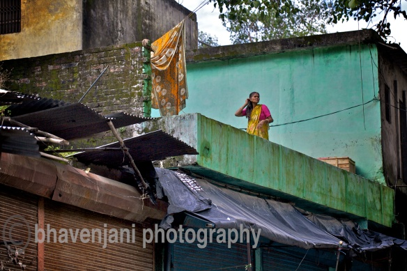 Woman on the terrace brushes her hair on an early morning in Rishikesh