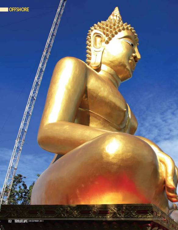 Double spread image of Lord Buddha atop 'Big Buddha' hill in Pattaya