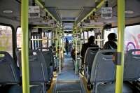 Image of inside of the HoHo bus of Delhi Tourism