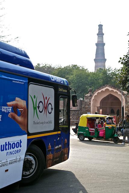 Image of Delhi Tourism's HoHo bus at Qutb Minar