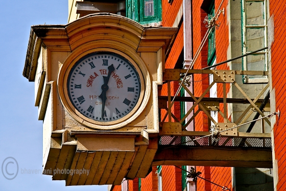 A massive clock at Gaiety theatre on Mall road in Shimla