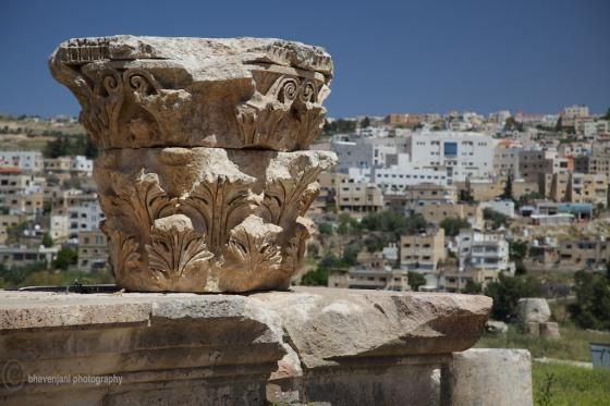 Detailed architecture is visible on a broken head of a pillar at Jarash, Jordan