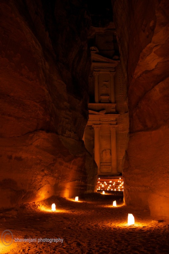 The Siq is lit by thousands of candles leading the visitor to The Treasury at Petra