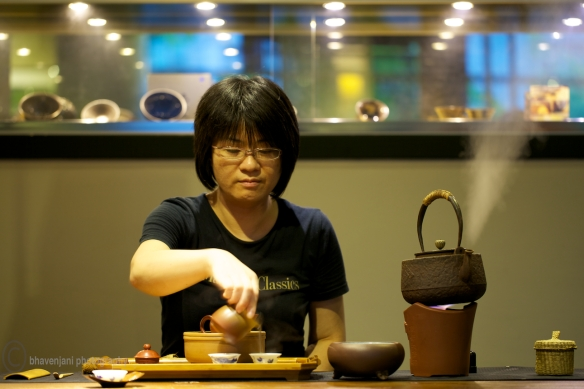 A student tries out his hand at tea making, Taichung, Taiwan