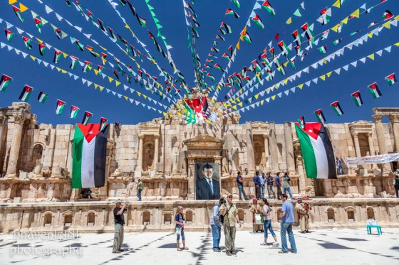 Decorations at the Roman theatre in Jerash, as tourists get entertained by bagpipers