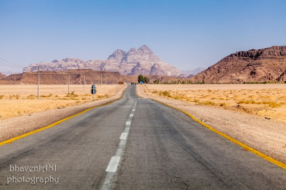 Road leading to Wadi Rum amidst enchanting landscape