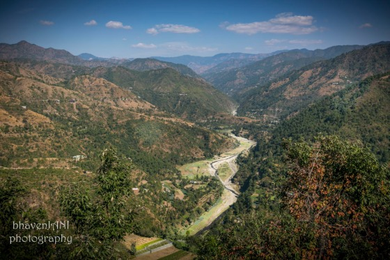 A river flows in a valley on the way up the hills to Kandaghat